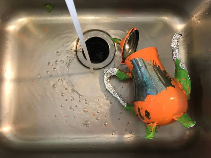 Washing paint off of teapot