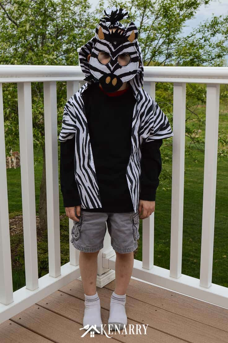 This easy kids zebra costume consists of a DIY vest and a zebra head mask. It's a cute Halloween costume idea or for a Zoophonics parade at school if your child loves Zeke the Zebra! #diyhalloweencostume #halloween #costume #halloween #kidscostumes #diycostumes #kenarry