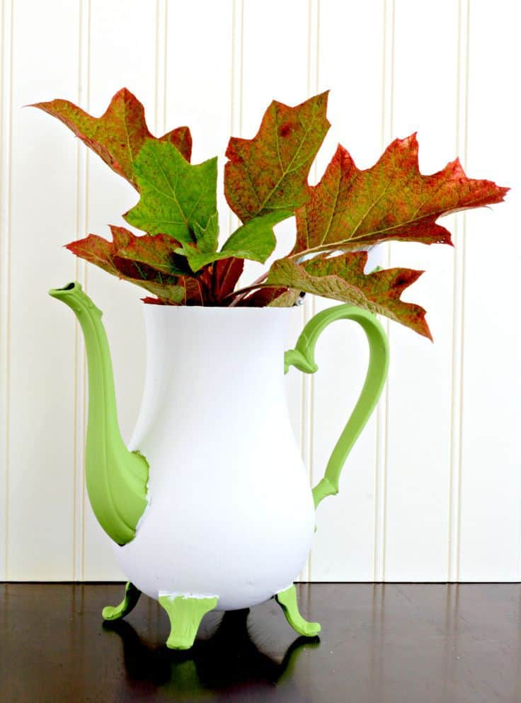 Upcycle an old teapot by painting it like a pumpkin! This easy DIY chalk painted pumpkin teapot is a great fall craft; it also works well for non-spooky Halloween decor! Give in to the fall neutrals trend and find a teapot to paint, pronto! #upcycle #crafts #diy #falldecor #pumpkins