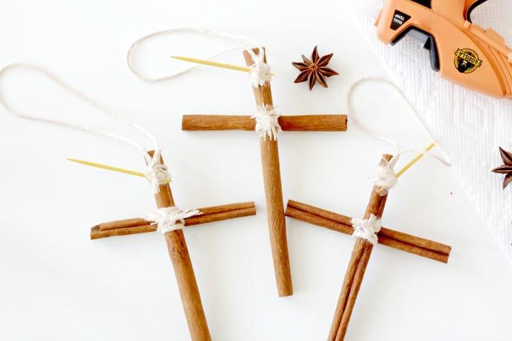 Three cinnamon stick crosses being hot glued