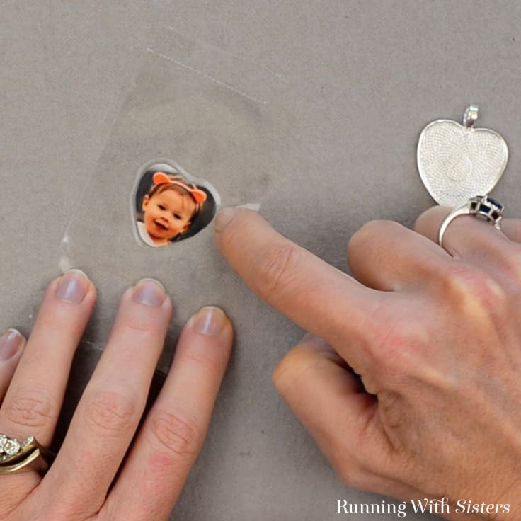 Make a DIY Heart Photo Keychain featuring your favorite photo. We'll show you how to make the picture pendant with resin and add beads to the keychain. #diy #crafts #giftideas #homemade
