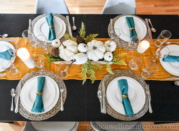 A fully made thanksgiving table setting