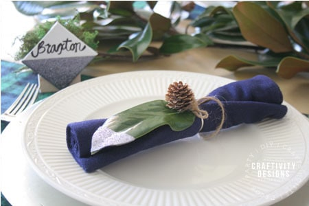 budget holiday table ideas, magnolia leaf, pinecone, washi tape