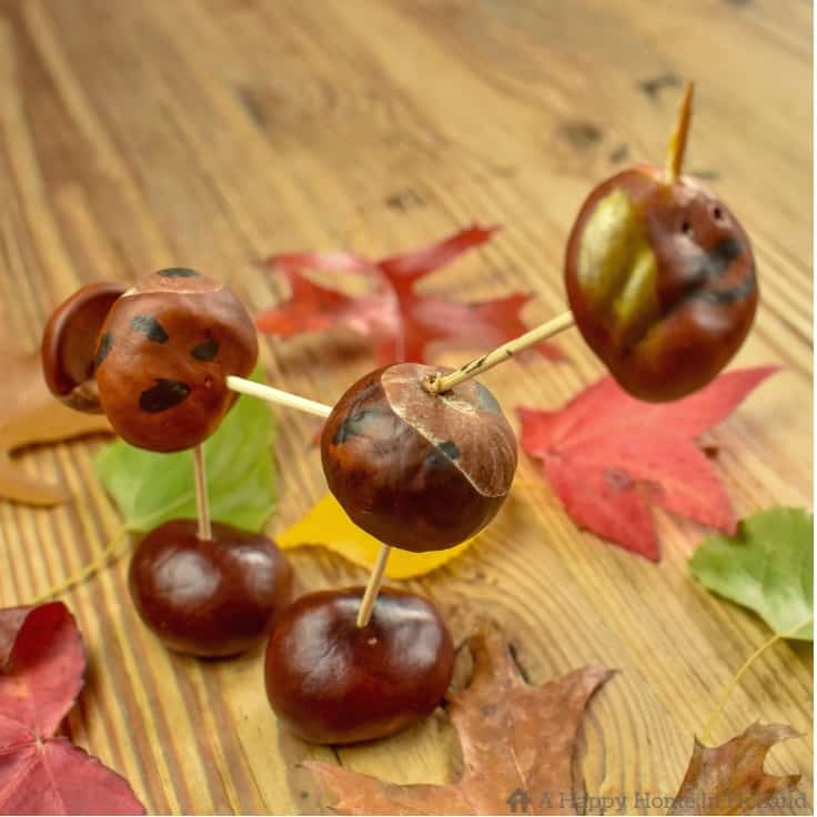 Learn how to make this easy fall art project of fun creative animals and characters using seasonal treasures found out and about and in the forest during the fall months. With a few chestnuts and pine cones, you'll be surprised just how many ideas the kids can come up with. #kidscrafts #fallart #kenarry