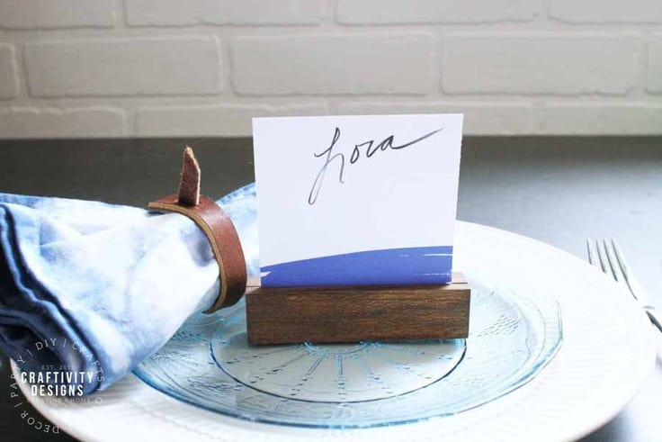 Learn how to make easy place card holders from wood. Whether you are setting a modern, farmhouse, or rustic table, these simple wood place card holders will do the trick!  Image by Craftivity Designs
