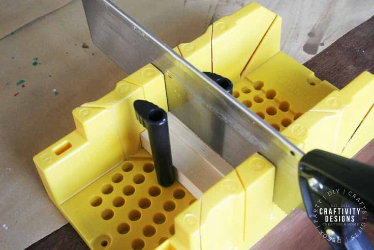 How to use a mitre box and saw to cut wood blocks. Image by Craftivity Designs