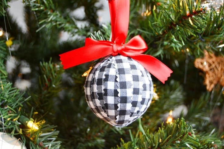 Have some old ornaments that are no longer your style?  Follow this tutorial for an easy Christmas ornament to make using old ones and some on trend fabric.