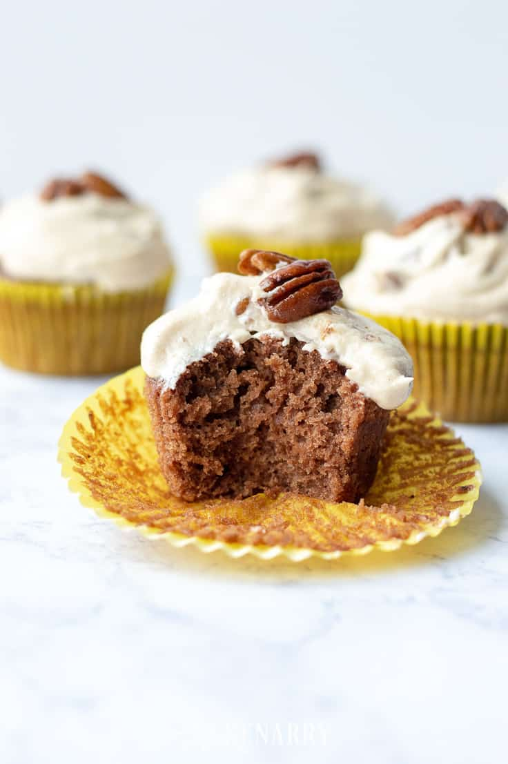 Need an easy dessert idea for a potluck or holiday party? These Easy Vegan Chocolate Cupcakes with Pecan Pie Frosting are sure to be the best crowd-pleaser. #vegan #vegandessert #kenarry
