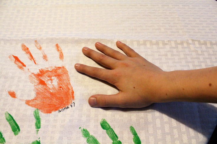 DIY Handprint Tablecloth: handprints on fabric