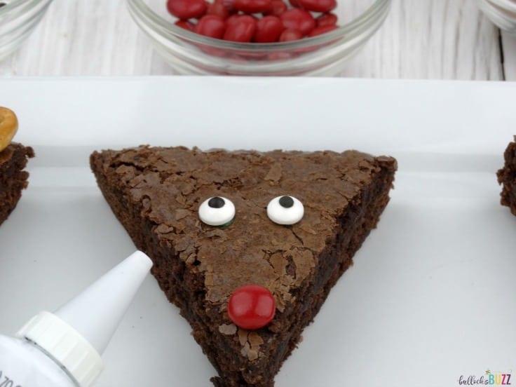 Add eyes and nose to reindeer brownies