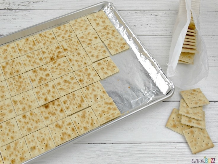 New Year's Eve Toffee Bark Recipe place crackers salty side down