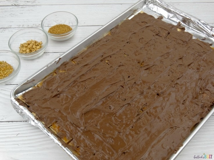 New Year's Eve Toffee Bark Recipe spread chocolate over toffee