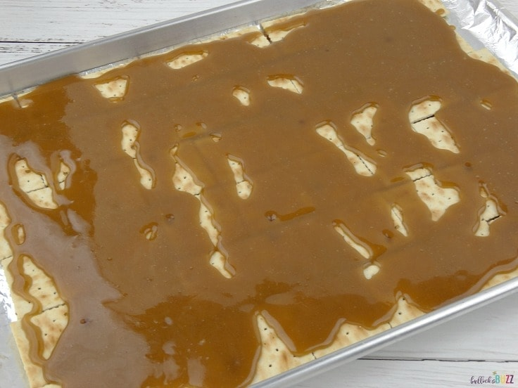 Pour hot toffee over crackers to make New Year's Eve Toffee Bark Recipe