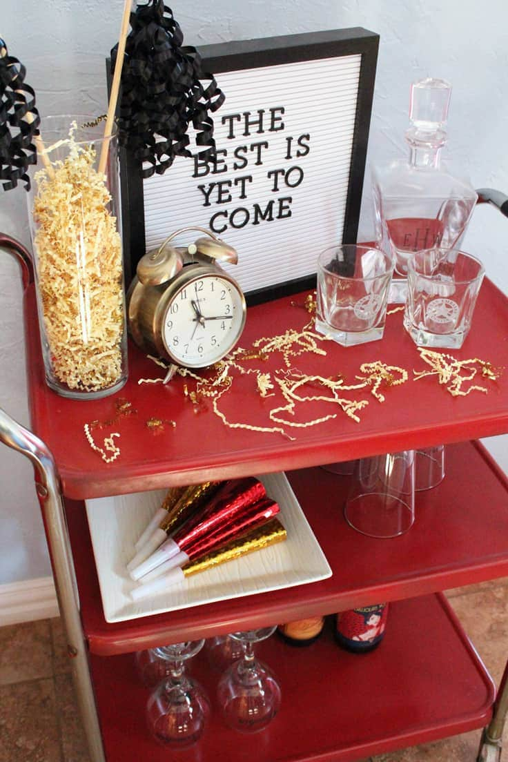 Update an old rolling cart with a simple paint job to turn it into a festive winter cocoa station, a New Year's Eve bar, or an everyday craft station. #barcart #hotcocoabar #kenarry