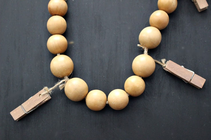 Wood beads with mini clothespins