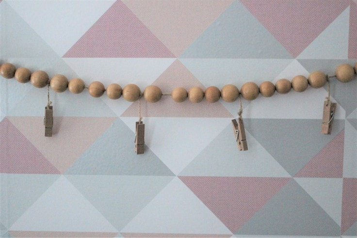 Wood Bead Garland Hanging With Mini Clothespins Attached