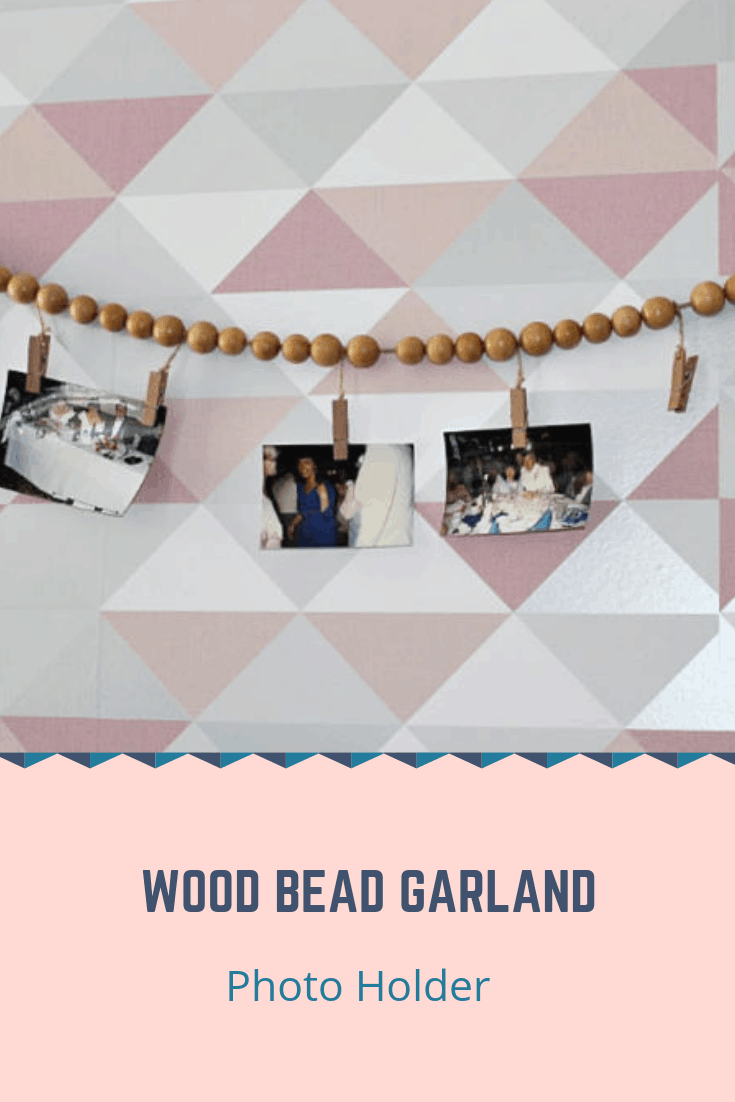 Learn how to make a DIY farmhouse style wood bead garland photo display that you can hang in your office, craft room or even your living room fireplace mantle. Change out the photos quickly and easily, or use it to display your seasonal decorations! #crafts #farmhousedecor #kenarry