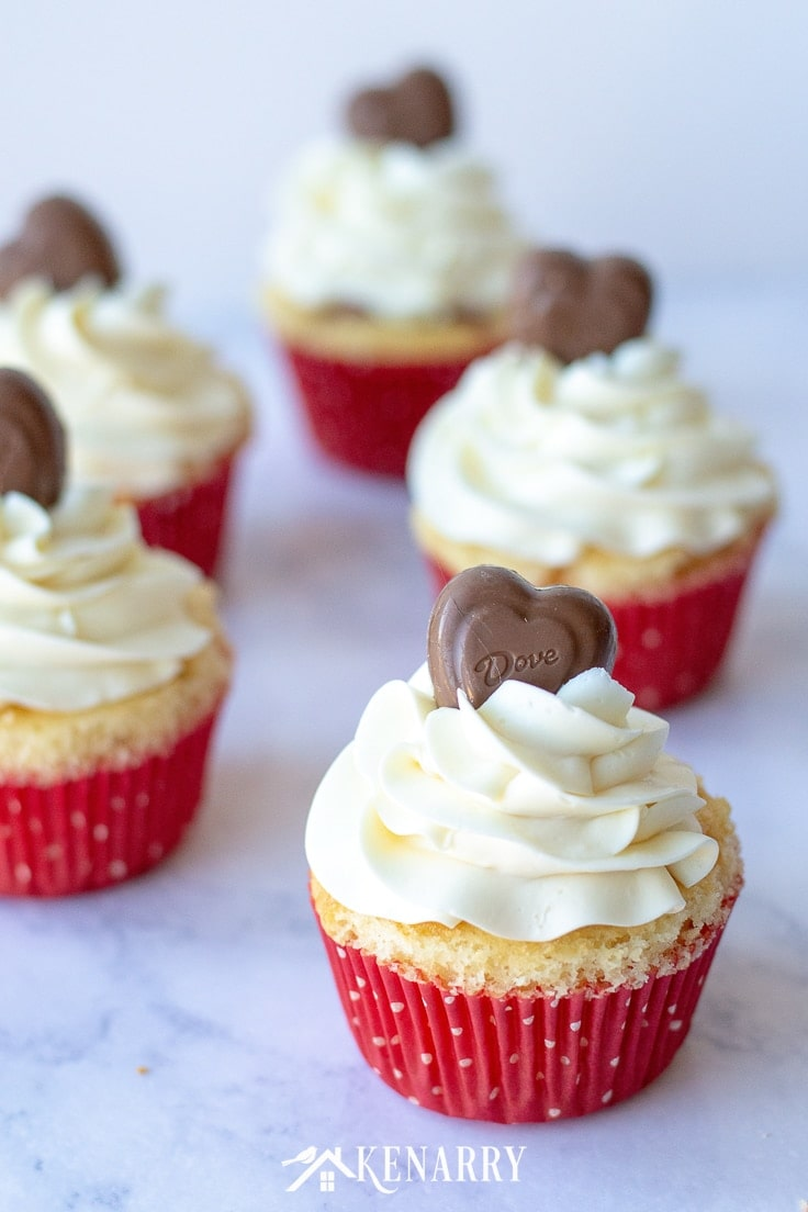 Surprise your sweetheart with this festive Valentine's Day Cupcakes recipe. This fun dessert idea has a hidden red velvet cake heart inside each of these delicious treats that is perfect for kids and adults. #valentines #cupcakerecipes #kenarry