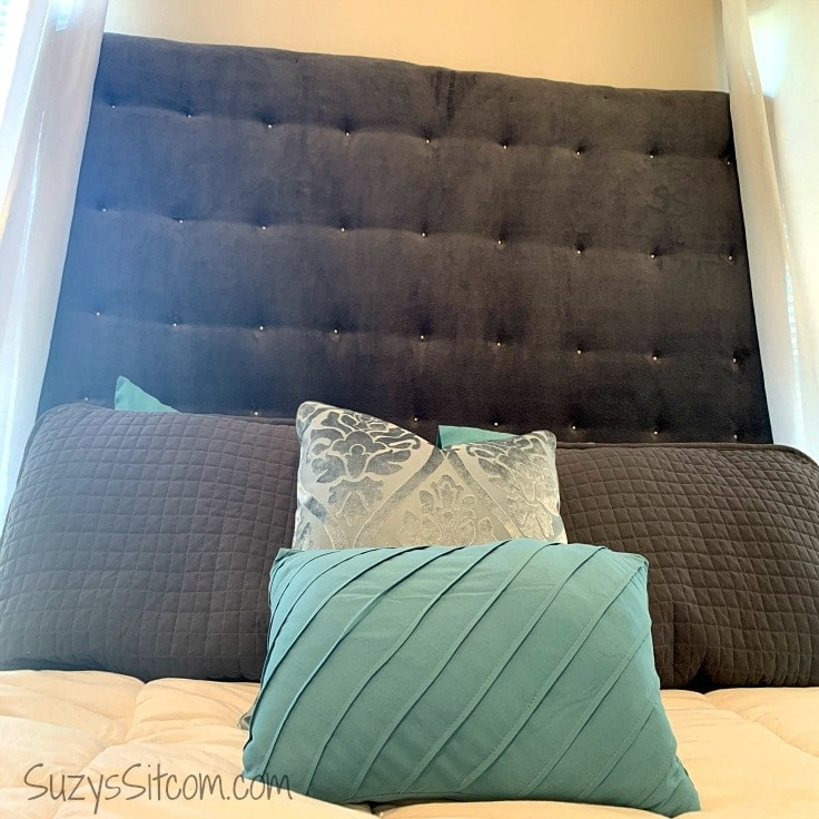 Learn how to make a fabric headboard for an elegant, elevated style to your bedroom design. Plus this beautiful, tufted DIY headboard is budget friendly! The instructions for this king sized upholstered headboard can easily be converted to a twin, queen, or any size bed. #bedroom #homedecor #kenarry