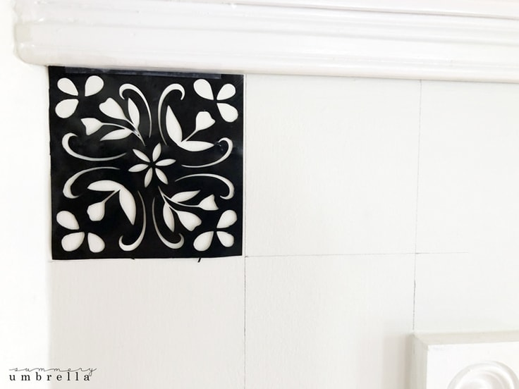 a black tile stencil ready to be painted.