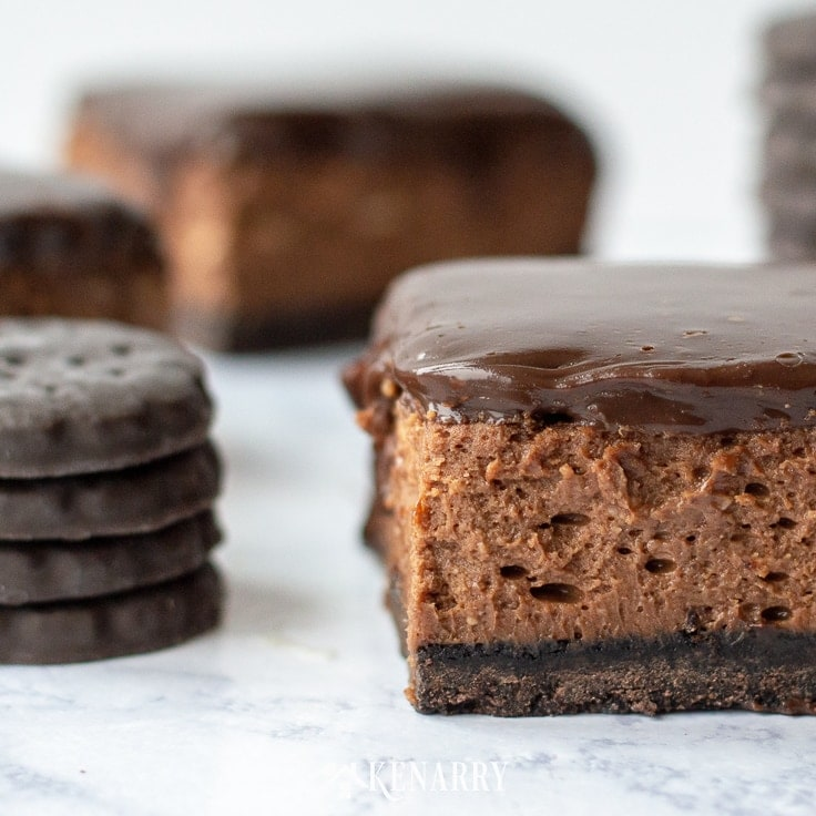 Looking for easy leftover Girl Scout cookie recipes? These delicious Chocolate Cheesecake Thin Mint Dessert Bars are exactly the sweet treat you need!