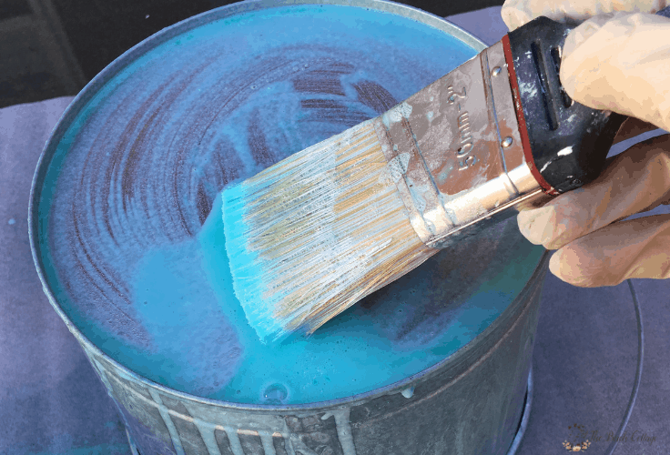 Using a brush to apply a thick gel to age galvanized metal.