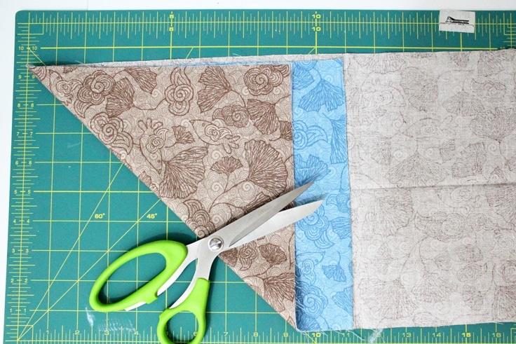 fabric on a table, folded diagonally