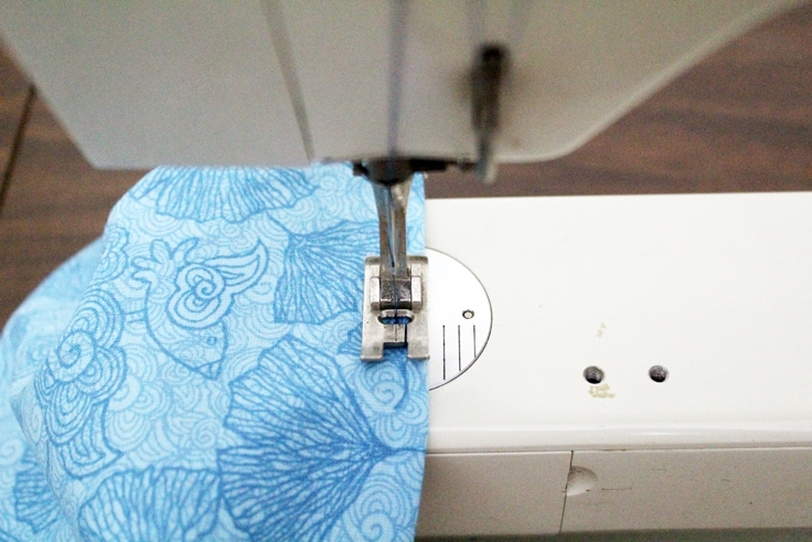 fabric on a sewing machine being hemmed