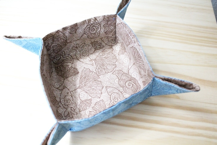A blue and brown fat quarter fabric tray with all four corners sewn to stand up