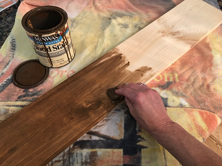 Staining a wood board that will be turned into a DIY hanging planter.