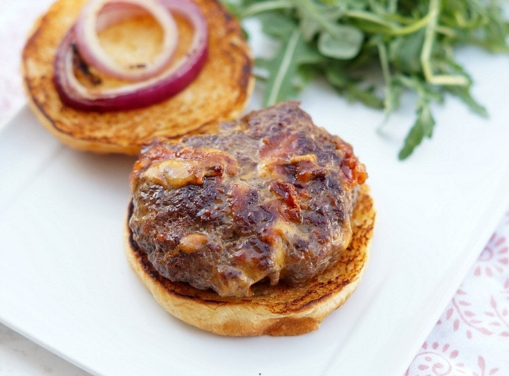 An open-faced bacon and cheddar stuffed burger