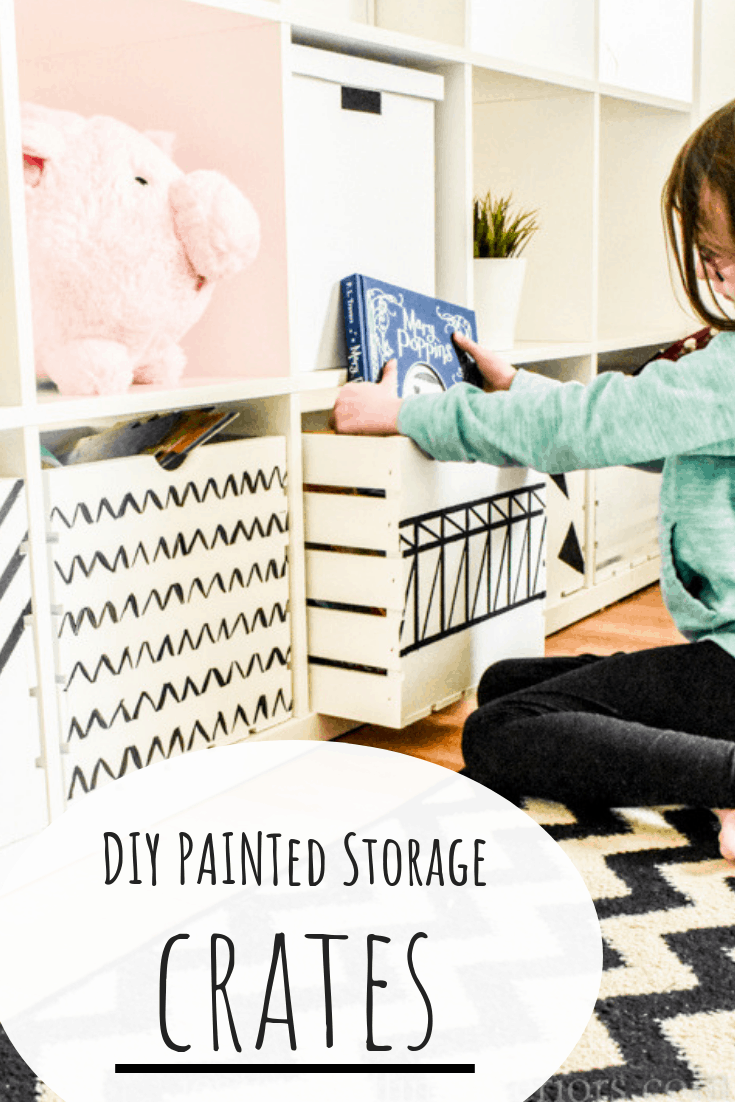 """A child pulls out the book Mary Poppins from a hand painted wood crate. Image reads """"DIY Painted Storage Crates"""""""