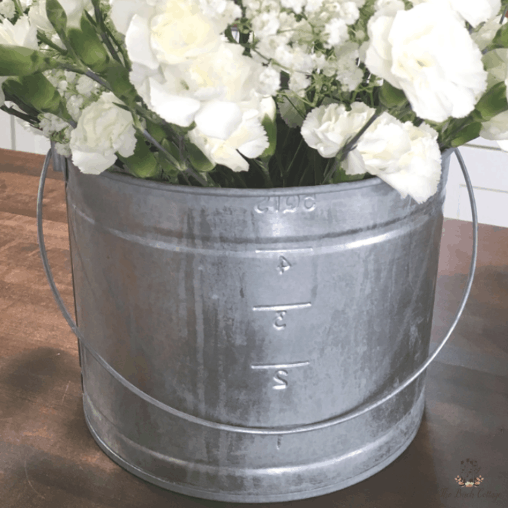 A Galvanized Metal Pail holding white flowers