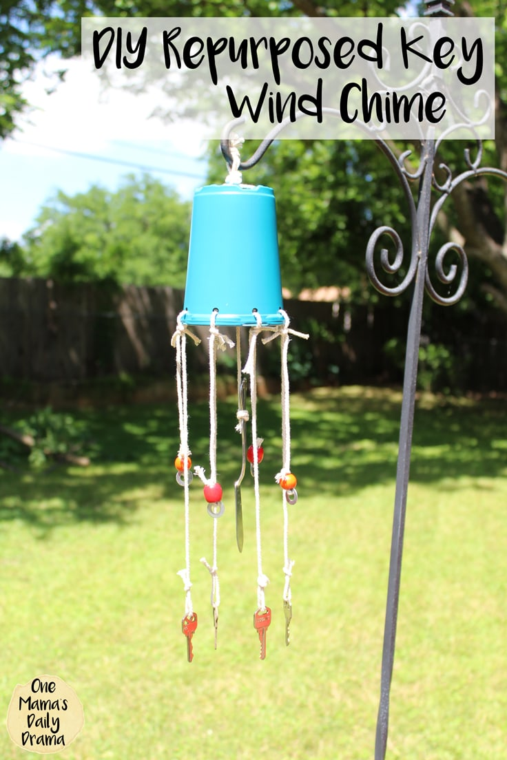 Blue potting container wind chime with keys hanging down - Photo reads - DIY Repurposed Key Wind Chime.