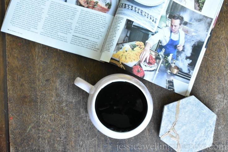 overhead image of kintsugi tile coasters being used with a coffee mug and magazine
