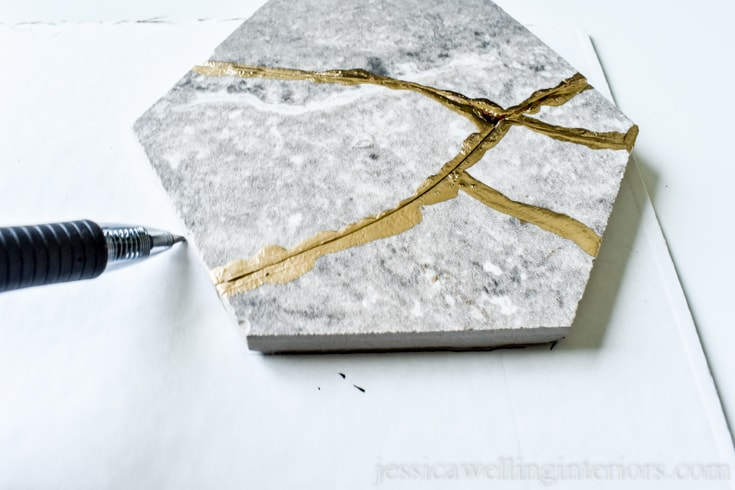 image of re-assembled kintsugi tile coaster being traced to make a coordinating cork backing for the coaster