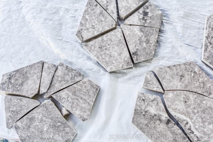image of broken hexagon tiles with pieces re-assembled to make wabi sabi coasters