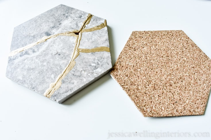 image of kintsugi tile coaster and matching hexagon-shaped piece of self-adhesive cork backing ready to be applied to the back of the coaster