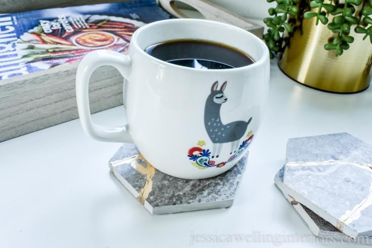image of diy kintsugi tile coasters with a mug of coffee and magazine tray