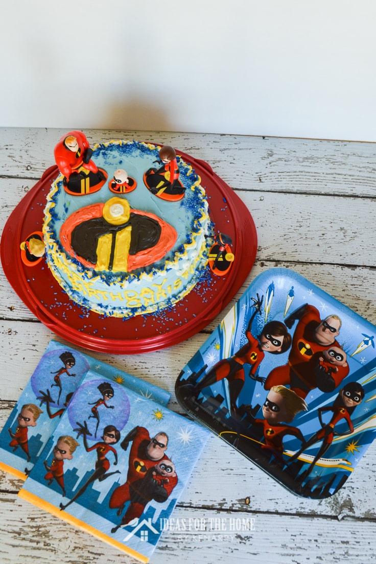 Incredibles birthday cake, napkins and paper plates ready for a child's birthday party
