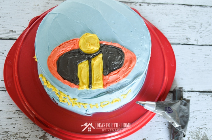 Overhead shot of the Incredibles 2 logo on top of a birthday cake