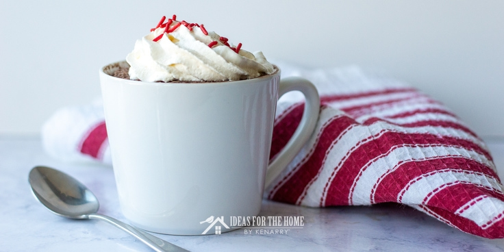 123 Cake in a ceramic mug topped with whipped cream and sprinkles