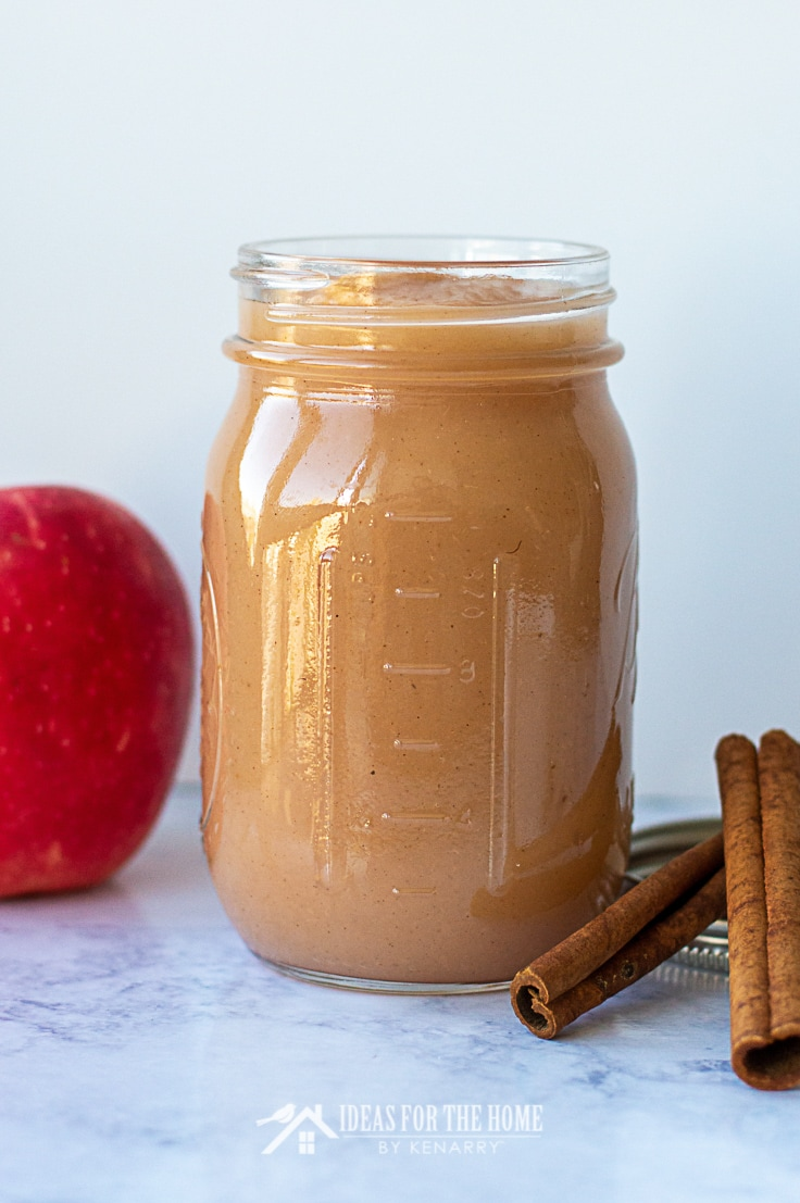 A mason jar of homemade baked cinnamon applesauce