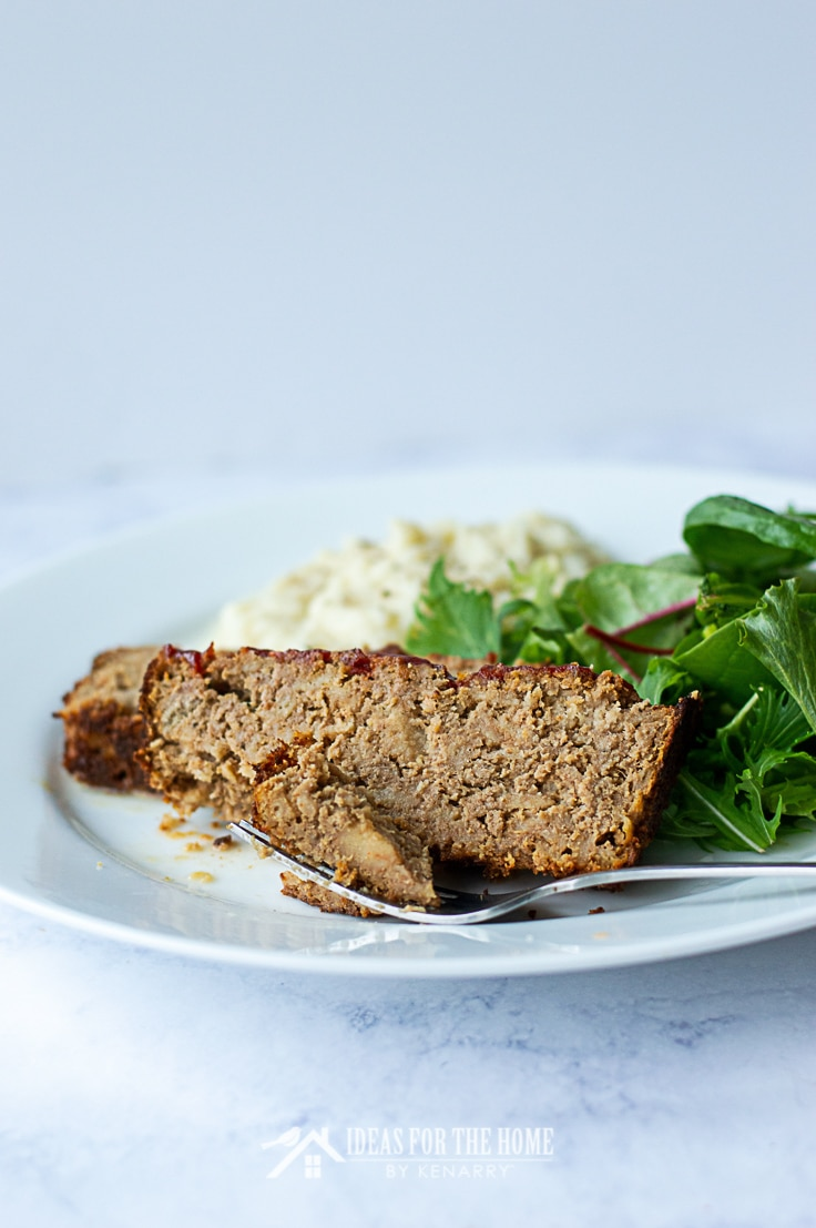 A plate with a piece of ground turkey meatloaf with a tasty bite on a fork