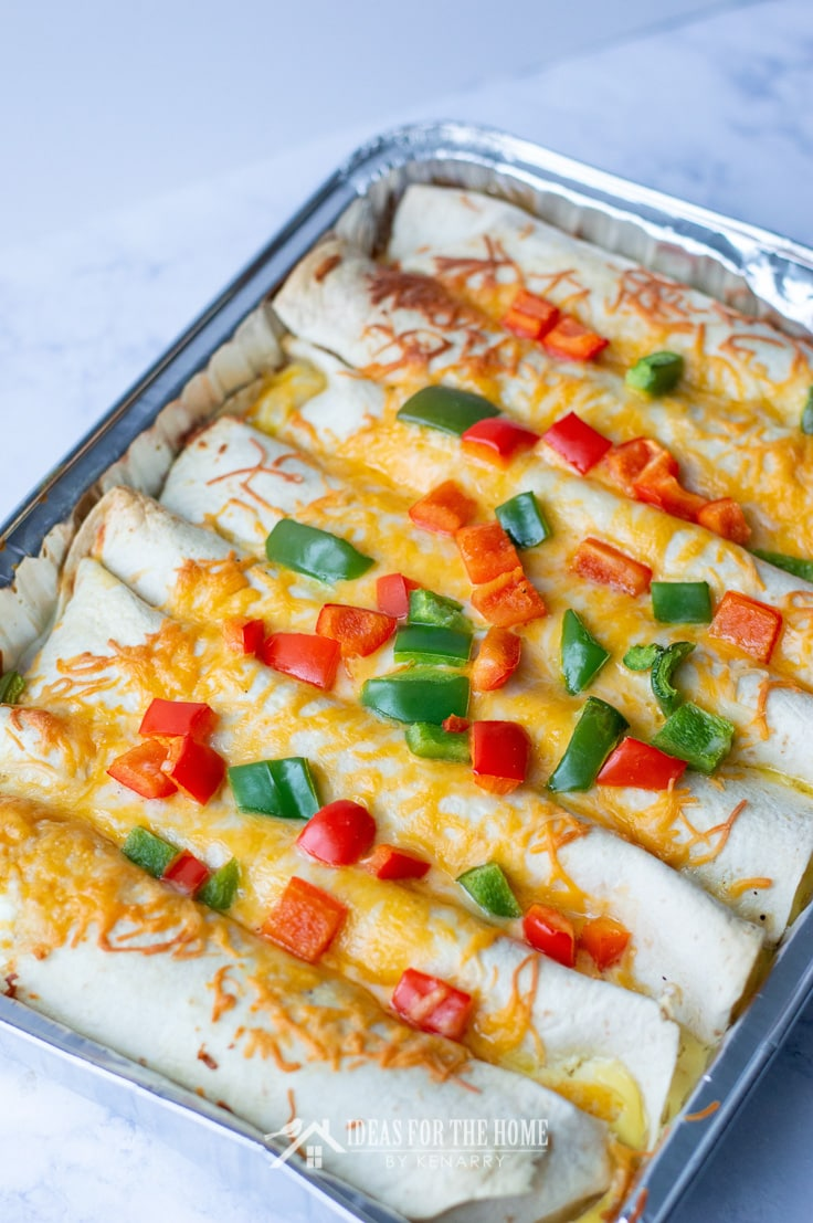 A foil pan filled with breakfast enchiladas for Christmas morning