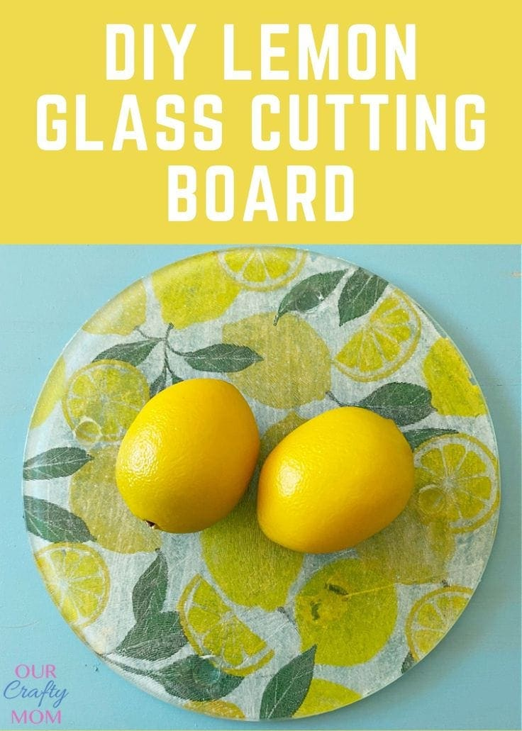 Glass cutting board on plate with lemons.