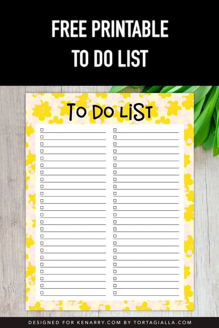 Preview of yellow floral printable to do list on wooden desktop with greenery in upper right corner.
