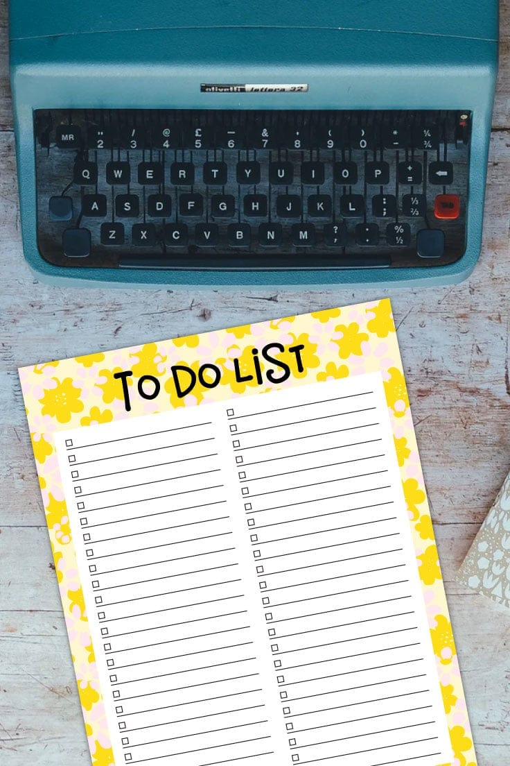 Preview of yellow floral printable to do list on wooden desktop with a turquoise vintage typewriter on top.