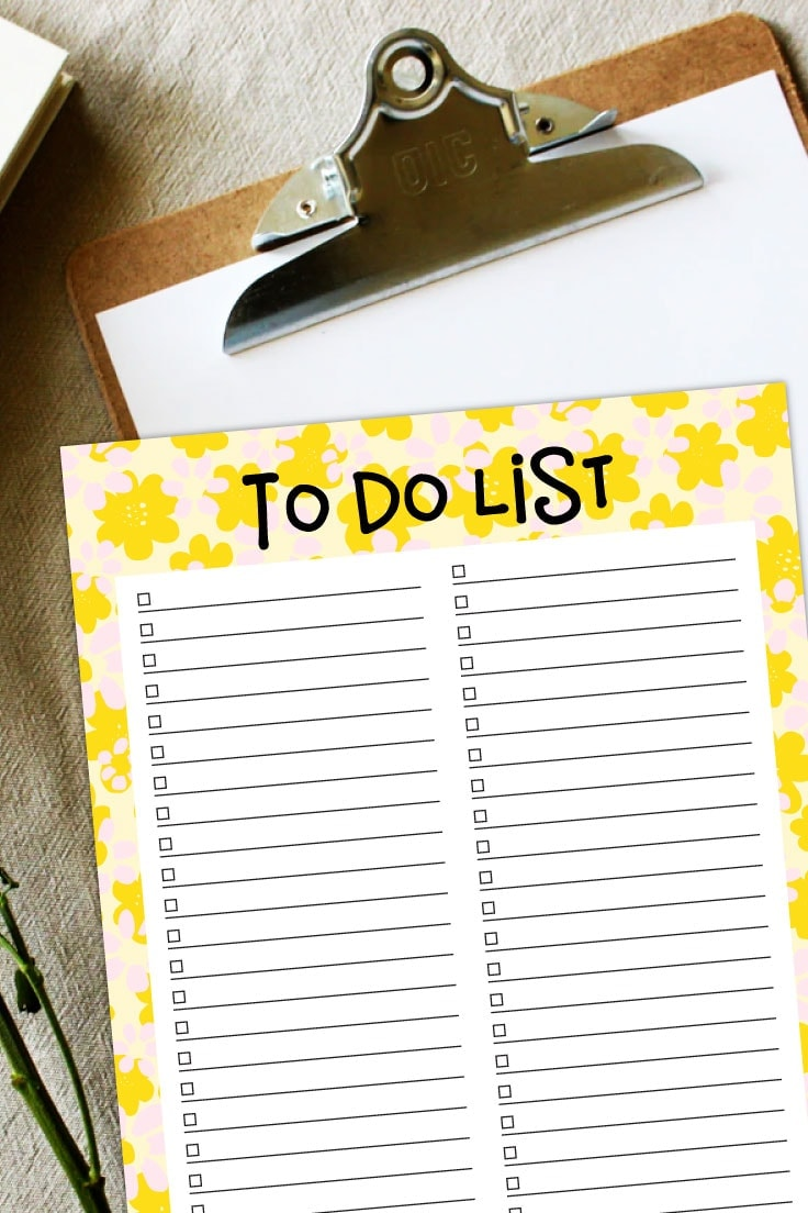 Preview of yellow floral printable to do list on top of wooden clipboard.