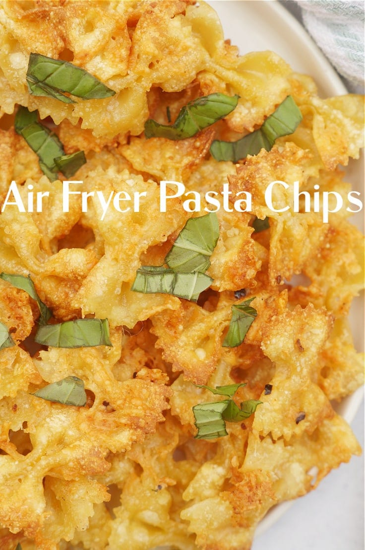 Air fryer pasta chips cooked to crispy brown and sprinkled with herbs.
